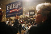 Casino and hotel employees cheer for their preferred presidential candidates before the start of the caucus 19 January 2008 at the Bellagio Hotel in...