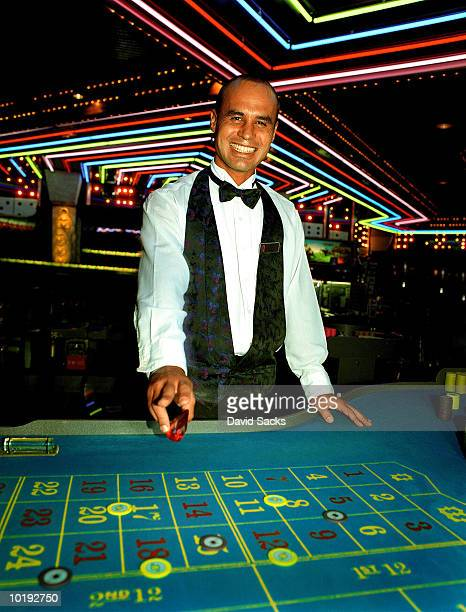 Casino dealer smiling, portrait