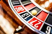 Wooden roulette wheeel in casino.