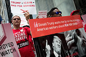 Casino workers and activists protest as they march from Trump Taj Mahal owner Carl Icahn's office on Fifth Avenue to Trump Tower July 13 2016 in New...