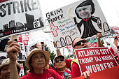 Casino workers and activists protest outside Trump Taj Mahal owner Carl Icahn's office on Fifth Avenue July 13 2016 in New York City Trump Taj Mahal...