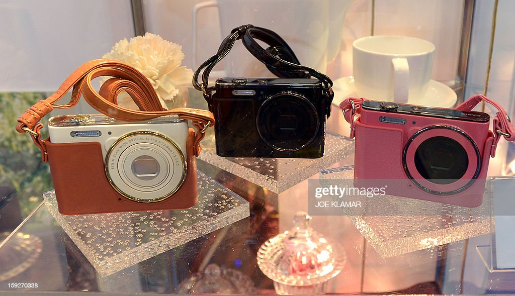 Casio's EX-J10 cameras on display at CASIO booth at the 2013 International CES at the Las Vegas Convention Center on January 10, 2013 in Las Vegas, Nevada. CES, the world's largest annual consumer technology trade show, runs from January 8-11 and is expected to feature 3,100 exhibitors showing off their latest products and services to about 150,000 attendees.AFP PHOTO / JOE KLAMAR