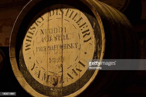 A cask containing pot still pure malt whisky sits in a warehouse at Suntory Holdings Ltd's Yamazaki distillery in Shimamoto Osaka Japan on Friday...