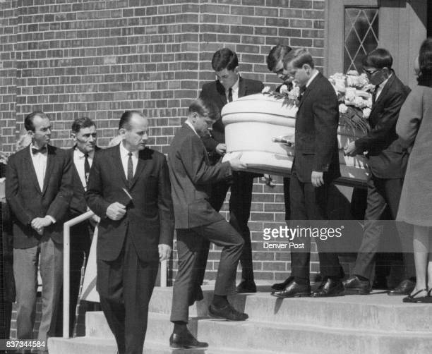 Casket Of Connie Paris Borne By Classmates Leaves The First Christian Church in Englewood Leading casket carrying Bible is the Rev Sherman Miller...