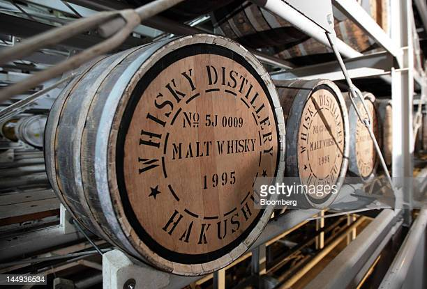 Casks containing malt whisky sit in a warehouse at Suntory Holdings Ltd's Hakushu distillery in Hokuto City Yamanashi Prefecture Japan on Monday May...