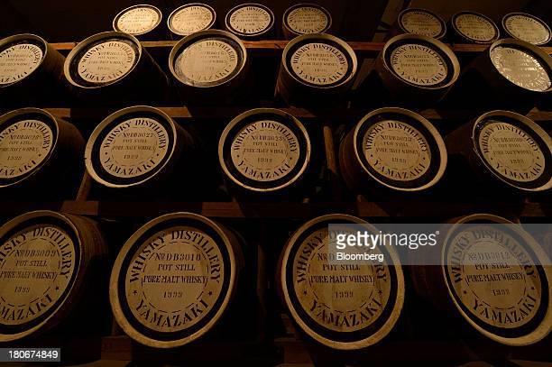 Casks containing pot still pure malt whisky sit in a warehouse at Suntory Holdings Ltd's Yamazaki distillery in Shimamoto Osaka Japan on Friday Sept...