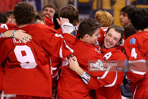 Cason Hohmann right and Evan Rodrigues celebrate the Terriers 43 win over the Northeastern Huskies in overtime during the 2015 Beanpot Tournament...
