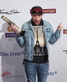 Casper holds his Echo Music Award for Best Urban Hip Hop at the Echo Award 2012 on March 22 2012 in Berlin Germany