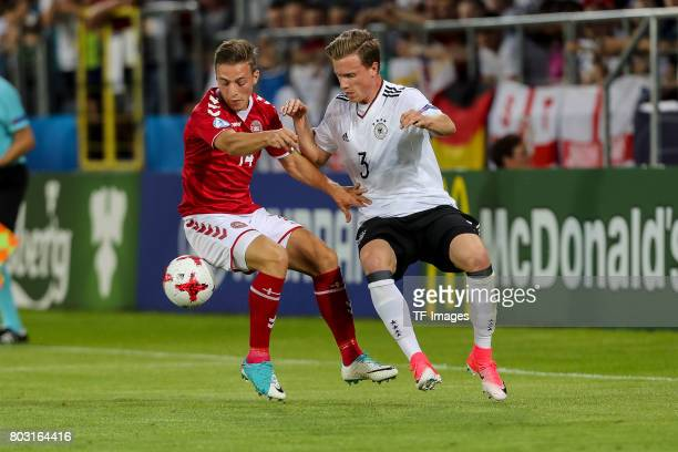Casper Nielsen of Denmark and Yannick Gerhardt of Germany battle for the ball during the UEFA European Under21 Championship Group C match between...