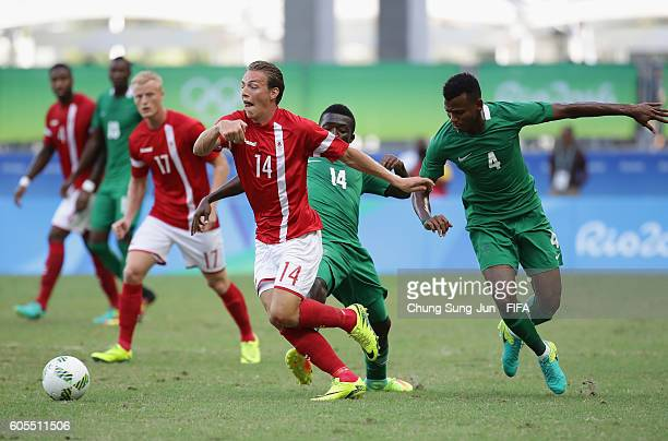 Casper Nielsen of Denmark competes for the ball with Abdullahi Shehu of Nigeria during the Men's Football Quarter Final match between Nigeria and...