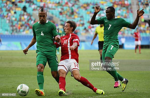 Casper Nielsen of Denmark competes for the ball with William Ekong of Nigeria during the Men's Football Quarter Final match between Nigeria and...