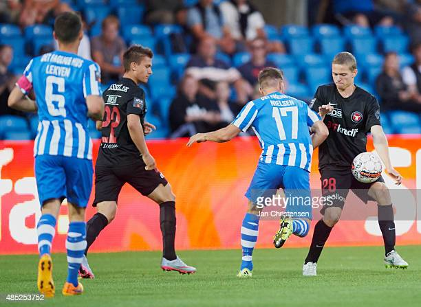 Casper Nielsen of Esbjerg fB and André Romer of FC Midtjylland compete for the ball during the Danish Alka Superliga match between Esbjerg fB and FC...