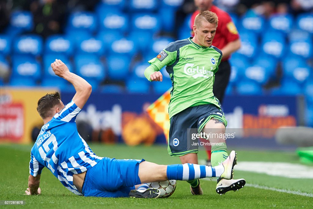 Casper Nielsen of Esbjerg fB and Ari Skulason of OB Odense compete for the ball during the Danish Alka Superliga match between Esbjerg fB and OB Odense at Blue Water Arena on May 02, 2016 in Esbjerg, Denmark.