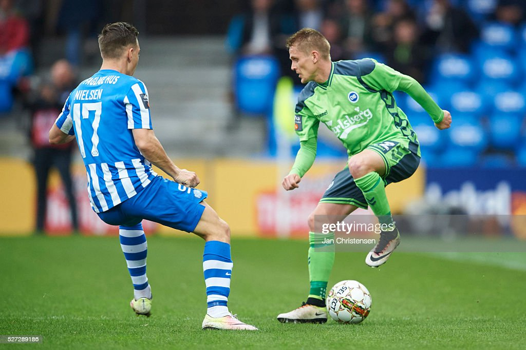 Casper Nielsen of Esbjerg fB and Ari Skulason of OB Odense in action during the Danish Alka Superliga match between Esbjerg fB and OB Odense at Blue Water Arena on May 02, 2016 in Esbjerg, Denmark.