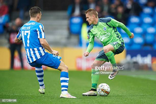 Casper Nielsen of Esbjerg fB and Ari Skulason of OB Odense in action during the Danish Alka Superliga match between Esbjerg fB and OB Odense at Blue...