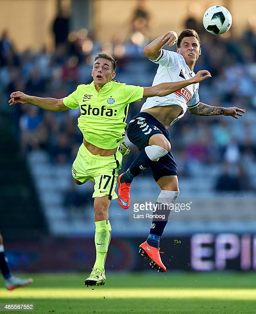Casper Nielsen of Esbjerg fB and Daniel A Pedersen of AGF Aarhus compete for the ball during the Danish Alka Superliga match between AGF Aarhus and...