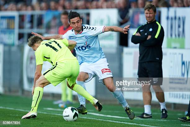 Casper Nielsen of Esbjerg fB and Joao Pereira of SonderjyskE compete for the ball during the Danish Alka Superliga match between SonderjyskE and...
