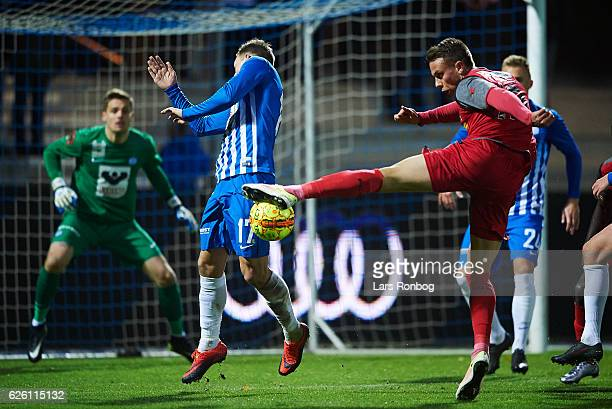 Casper Nielsen of Esbjerg fB and Marcus Ingvartsen of FC Nordsjalland compete for the ball during the Danish Alka Superliga match between Esbjerg fB...