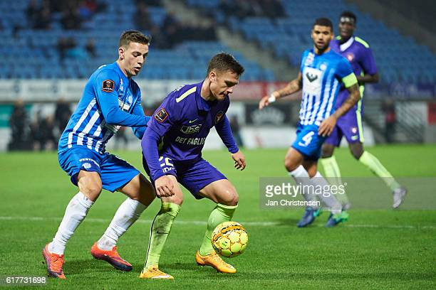 Casper Nielsen of Esbjerg fB and Mikkel Duelund of FC Midtjylland compete for the ball during the Danish Alka Superliga match between Esbjerg fB and...