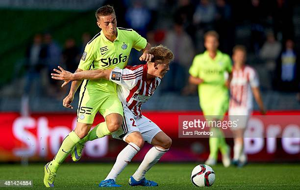 Casper Nielsen of Esbjerg fB and Nicolaj Thomsen of AaB Aalborg compete for the ball during the Danish Alka Superliga match between AaB Aalborg and...