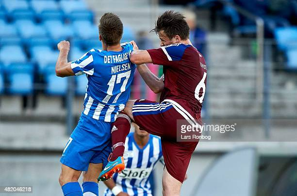 Casper Nielsen of Esbjerg fB and William Kvist of FC Copenhagen compete for the ball during the Danish Alka Superliga match between Esbjerg fB and FC...