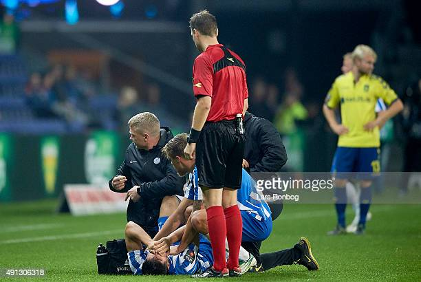 Casper Nielsen of Esbjerg fB is injured during the Danish Alka Superliga match between Brondby IF and Esbjerg fB at Brondby Stadion on October 4 2015...