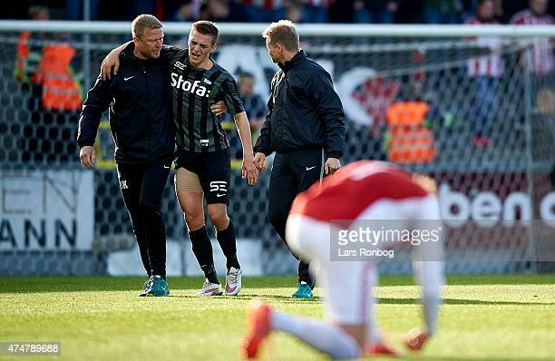 Casper Nielsen of Esbjerg FB leaves the pitch with an injury during the Danish Alka Superliga match between AaB Aalborg and Esbjerg fB at Nordjyske...
