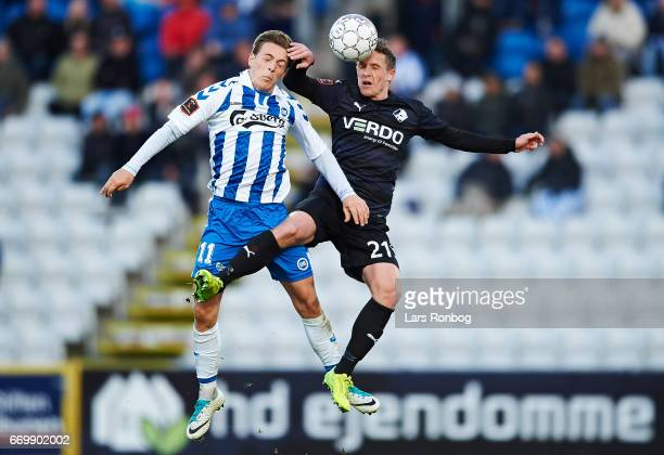 Casper Nielsen of OB Odense and Alexander Fischer of Randers FC compete for the ball during the Danish Alka Superliga match between OB Odense and...