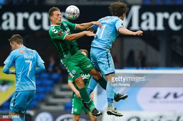 Casper Nielsen of OB Odense and Erik Marxen of Randers FC compete for the ball during the Danish Alka Superliga match between Randers FC and OB...
