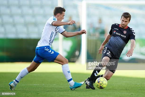 Casper Nielsen of OB Odense and Filip Lesniak of AaB Aalborg compete for the ball during the Danish Alka Superliga match between OB Odense and AaB...