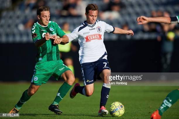 Casper Nielsen of OB Odense and Jakob Ankersen of AGF Aarhus compete for the ball during the Danish Alka Superliga match between AGF Aarhus and OB...