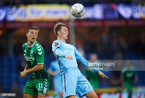 Casper Nielsen of OB Odense and Viktor Lundberg of Randers FC compete for the ball during the Danish Alka Superliga match between Randers FC and OB...