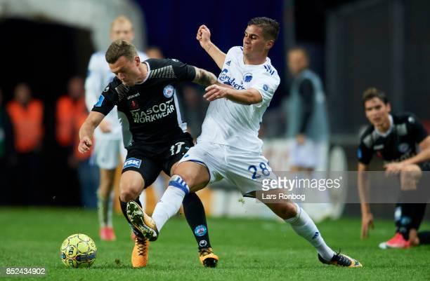 Casper Sloth of Silkeborg IF and Pieros Sotiriou of FC Copenhagen compete for the ball during the Danish Alka Superliga match between FC Copenhagen...