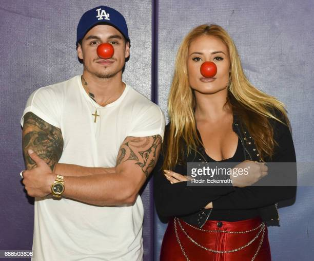 Casper Smart and Montana Tucker pose for portrait during Red Nose Day at Union Rescue Mission on May 25 2017 in Los Angeles California
