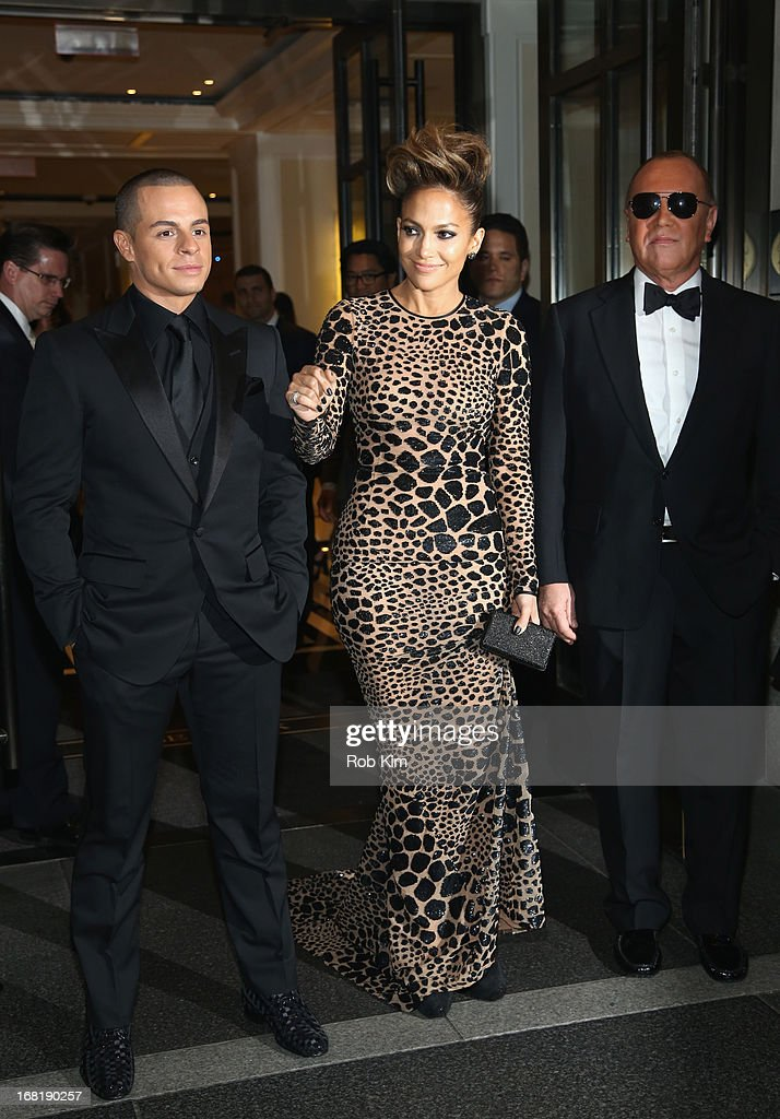 Casper Smart Jennifer Lopez and Designer Michael Kors depart the Mark Hotel for the 'PUNK Chaos To Couture' Costume Institute Gala at the...