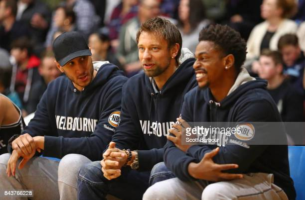 Casper Ware Josh Boone and David Andersen of United look on from the bench during the 2017 NBL Blitz preseason match between Melbourne United and the...