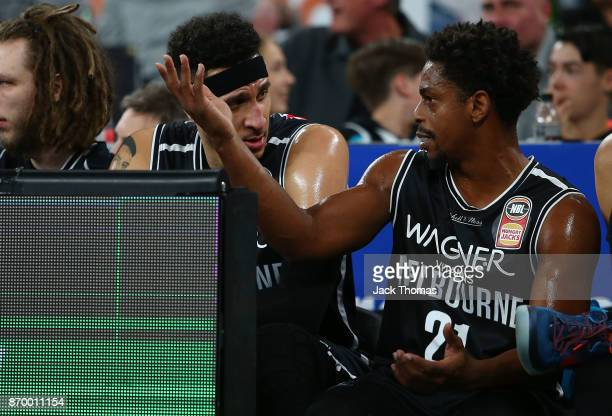 Casper Ware Jr and Josh Boone of Melbourne United talk on the bench during the round five NBL match between Melbourne United and the Adelaide 36ers...