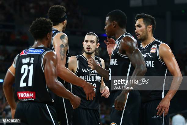 Casper Ware Jr Josh Boone Chris Goulding Casey Prather and Tai Wesley high five during the round six NBL match between Melbourne United and the...
