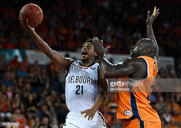 Casper Ware of Melbourne United attempts a lay up past Nathan Jawai of the Taipans during the round 13 NBL match between Cairns and Melbourne on...