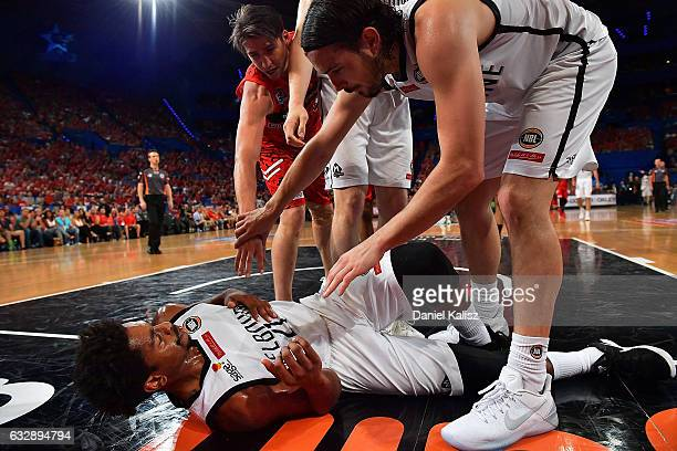 Casper Ware of Melbourne United is helped up by Chris Goulding of Melbourne United during the round 17 NBL match between the Perth Wildcats and...