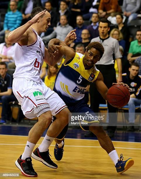 Casper Ware of Oldenburg challenges Karsten Tadda of Bamberg for the ball during the BEKO BBL Top Four final game between EWE Baskets Oldenburg and...