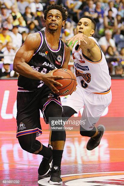 Casper Ware of United makes a basket against Travis Trice of the Taipans during the round 15 NBL match between Melbourne United and the Cairns...