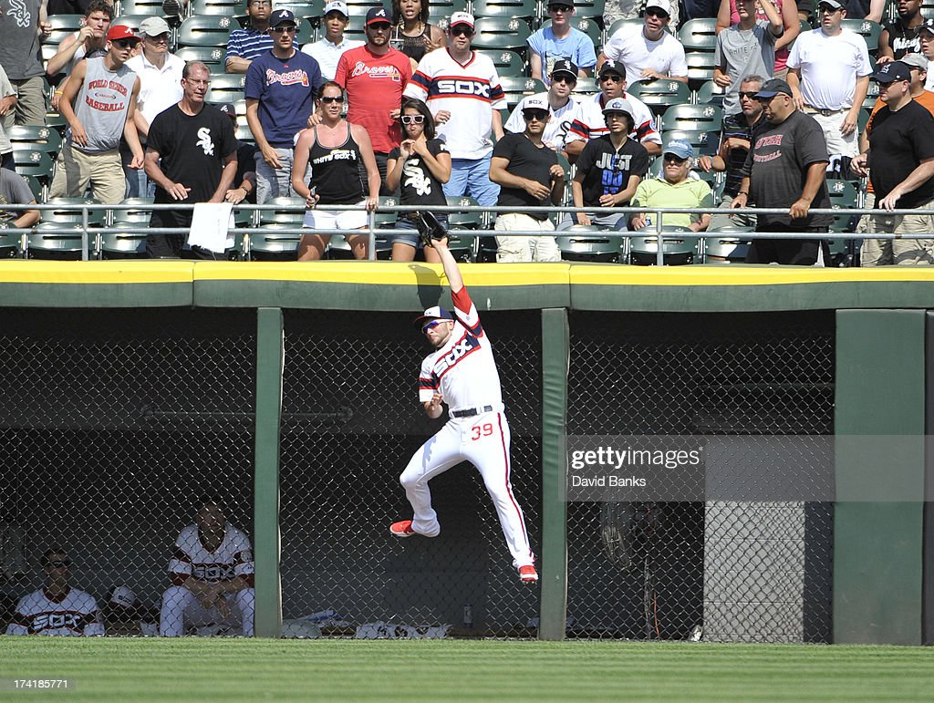<a gi-track='captionPersonalityLinkClicked' href=/galleries/search?phrase=Casper+Wells&family=editorial&specificpeople=5747458 ng-click='$event.stopPropagation()'>Casper Wells</a> #39 of the Chicago White Sox robs Reed Johnson #7 of the Atlanta Braves of a home run during the eighth inning on July 21, 2013 at U.S. Cellular Field in Chicago, Illinois. The Chicago White Sox defeated the Atlanta Braves 3-1.