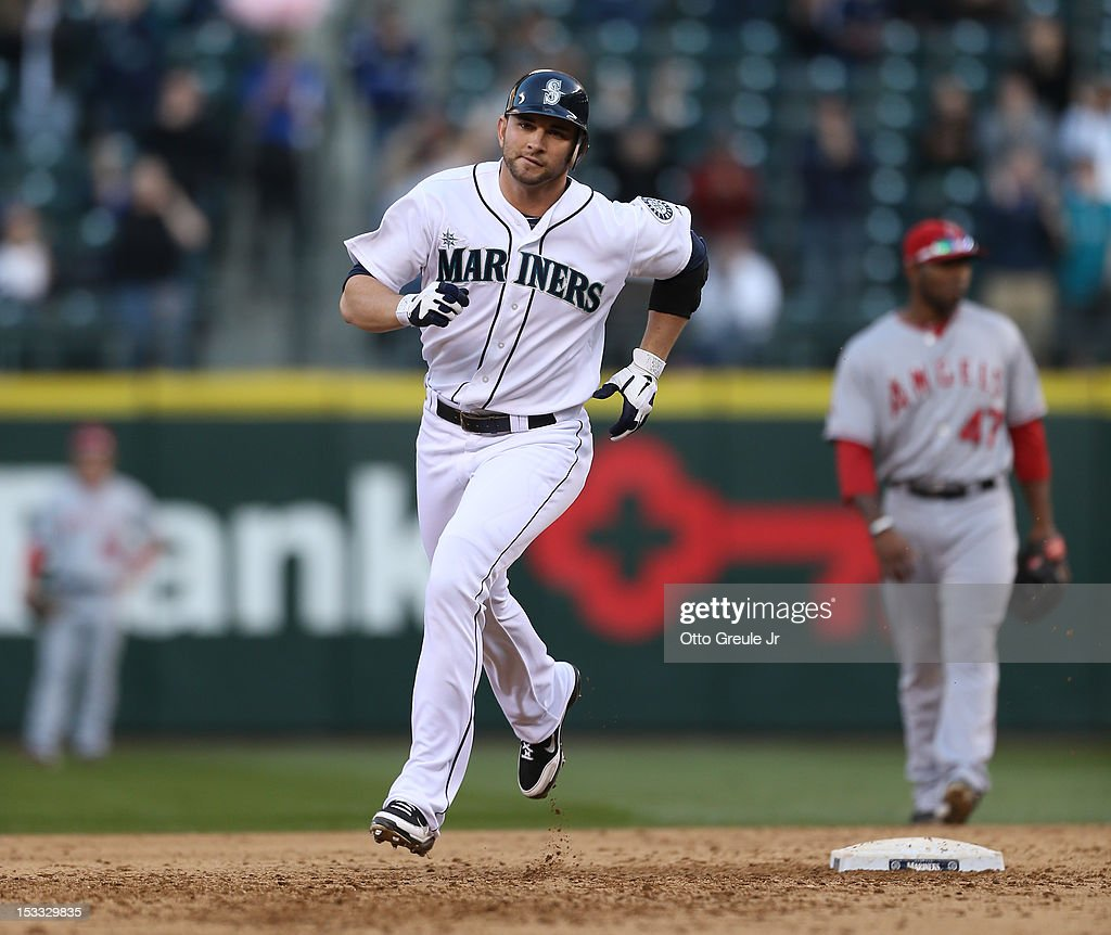 Casper Wells #33 of the Seattle Mariners rounds the bases after hitting a three-run home run against the Los Angeles Angels of Anaheim at Safeco Field on October 3, 2012 in Seattle, Washington.