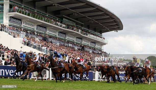 Caspian Prince ridden by Adam Kirby on their way to victory in the Investec Specialist Bank Dash during Investec Derby Day at Epsom Downs Racecourse...