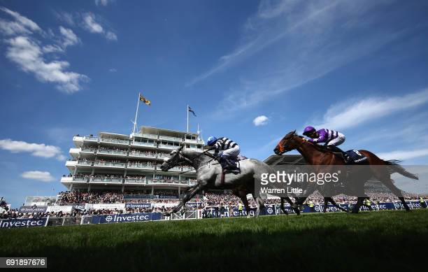 Caspian Prince riding by Tom Eaves wins The Investec Corporate Banking âDashâ Handicap Stakesduring the Investec Derby Day at Epsom Downs Racecourse...