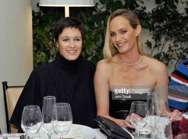 Cassandra Grey and Amber Valletta attend THE OUTNET x Amber Valletta at Waldorf Astoria Beverly Hills on October 19 2017 in Beverly Hills California