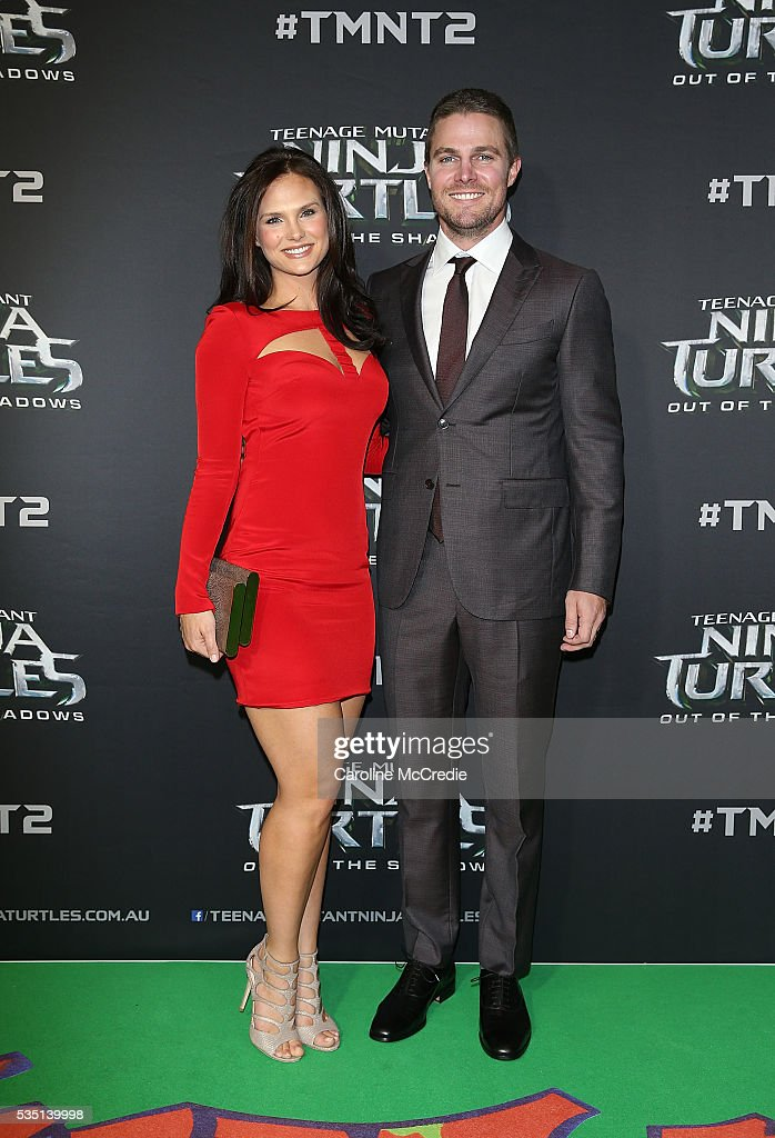 Cassandra Jean and <a gi-track='captionPersonalityLinkClicked' href=/galleries/search?phrase=Stephen+Amell&family=editorial&specificpeople=4500297 ng-click='$event.stopPropagation()'>Stephen Amell</a> arrive ahead of the Australian premiere of Teenage Mutant Ninja Turtles 2 at Event Cinemas George Street on May 29, 2016 in Sydney, Australia.