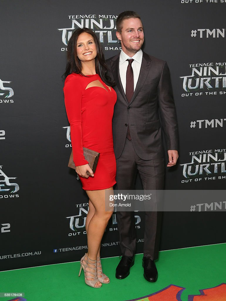 Cassandra Jean and Stephen Amell attends the Australian Premiere of Teenage Mutant Ninja Turtles 2 at Event Cinemas George Street on May 29, 2016 in Sydney, Australia.