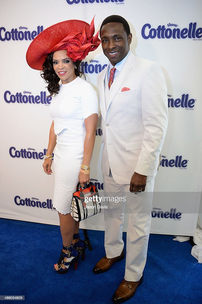 Cassandra Johnson (L) and <a gi-track='captionPersonalityLinkClicked' href=/galleries/search?phrase=Avery+Johnson&family=editorial&specificpeople=201655 ng-click='$event.stopPropagation()'>Avery Johnson</a> attend Cottonelle Celebrity 'Clean Room' at the 140th Kentucky Derby at Churchill Downs on May 3, 2014 in Louisville, Kentucky.